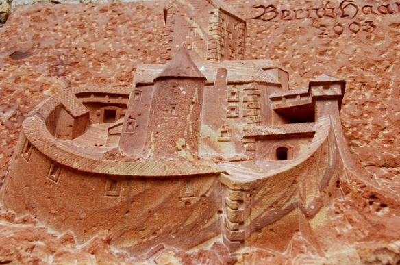 A carving of the castle as it was centuries ago.